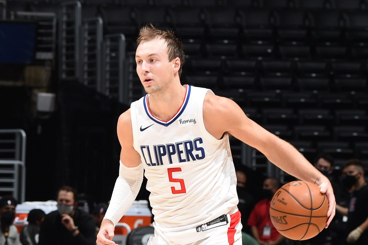 Luke Kennard of the LA Clippers handles the ball against the Utah Jazz during a preseason game on December 17, 2020 at STAPLES Center in Los Angeles, California.