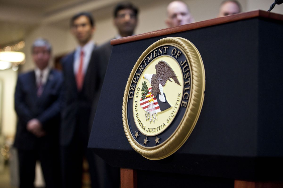The US Department of Justice seal.