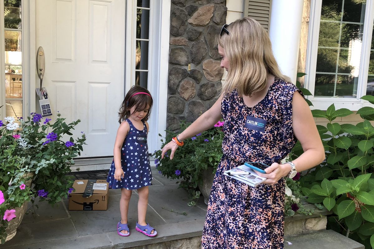 Caitlin Clarkson Pereira on the campaign trail in Connecticut with her daughter, Parker