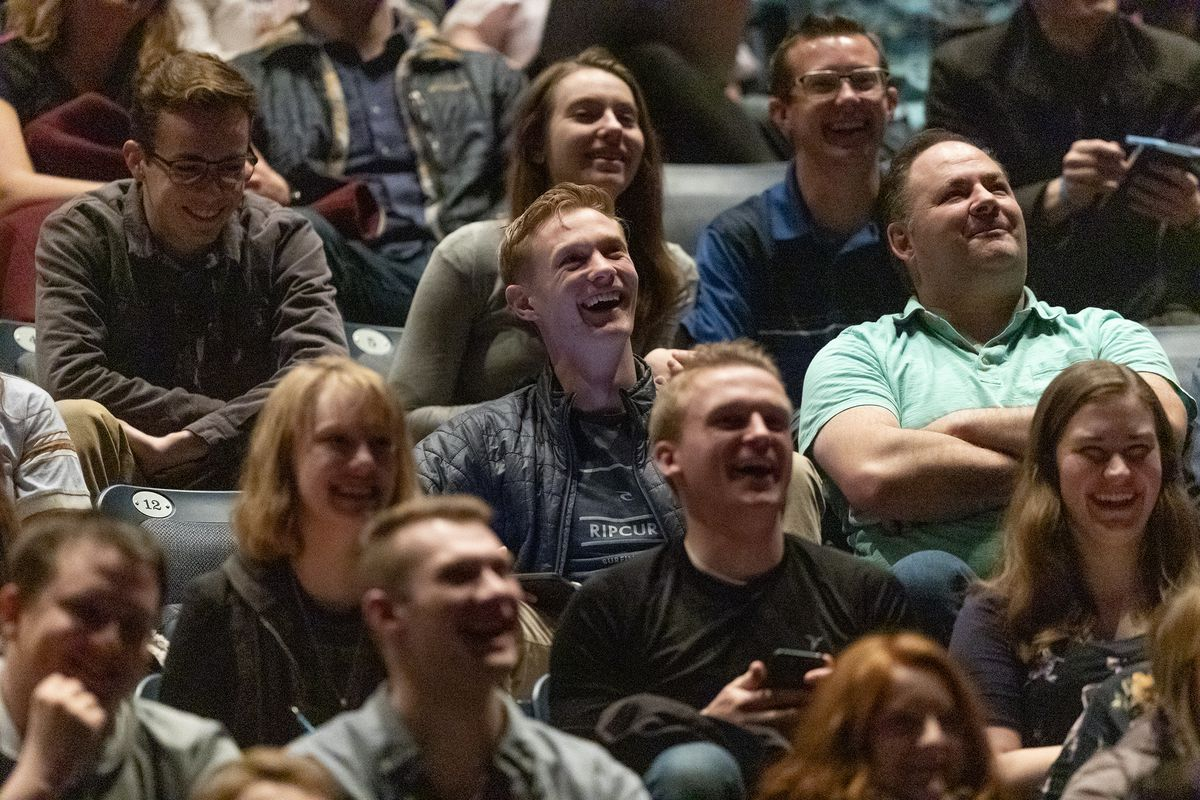 Students laugh as President M. Russell Ballard, acting president of the Quorum of the Twelve Apostles of The Church of Jesus Christ of Latter–day Saints, talks about using his smartphone and technology as he speaks at a BYU devotional in the Marriott Center in Provo on Tuesday, March 3, 2020.