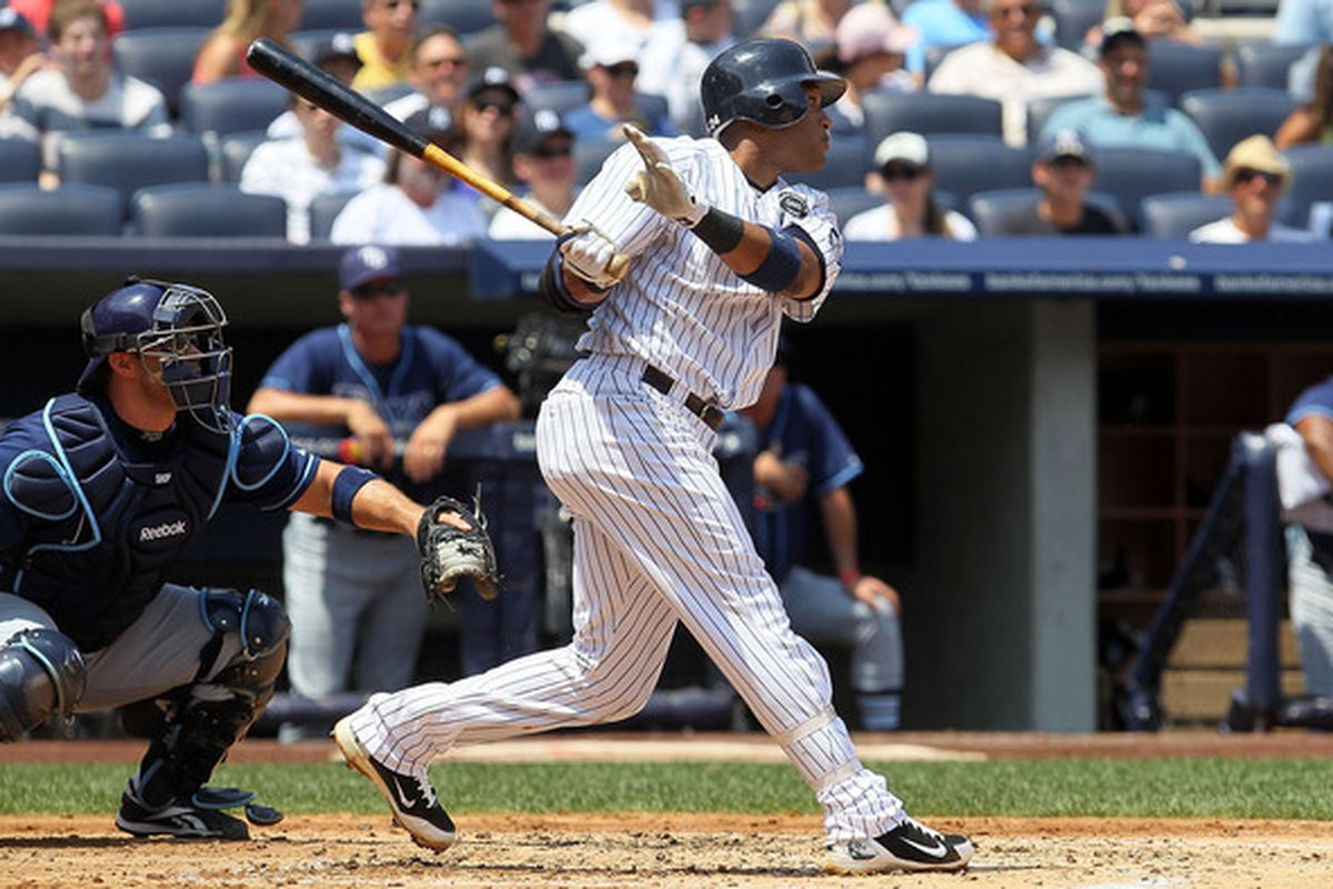 NEW YORK - JULY 18:  Robinson Cano #24 of the New York Yankees follows through on a first inning two run triple against the Tampa Bay Rays on July 18 2010 at Yankee Stadium in the Bronx borough of New York City.  (Photo by Jim McIsaac/Getty Images)