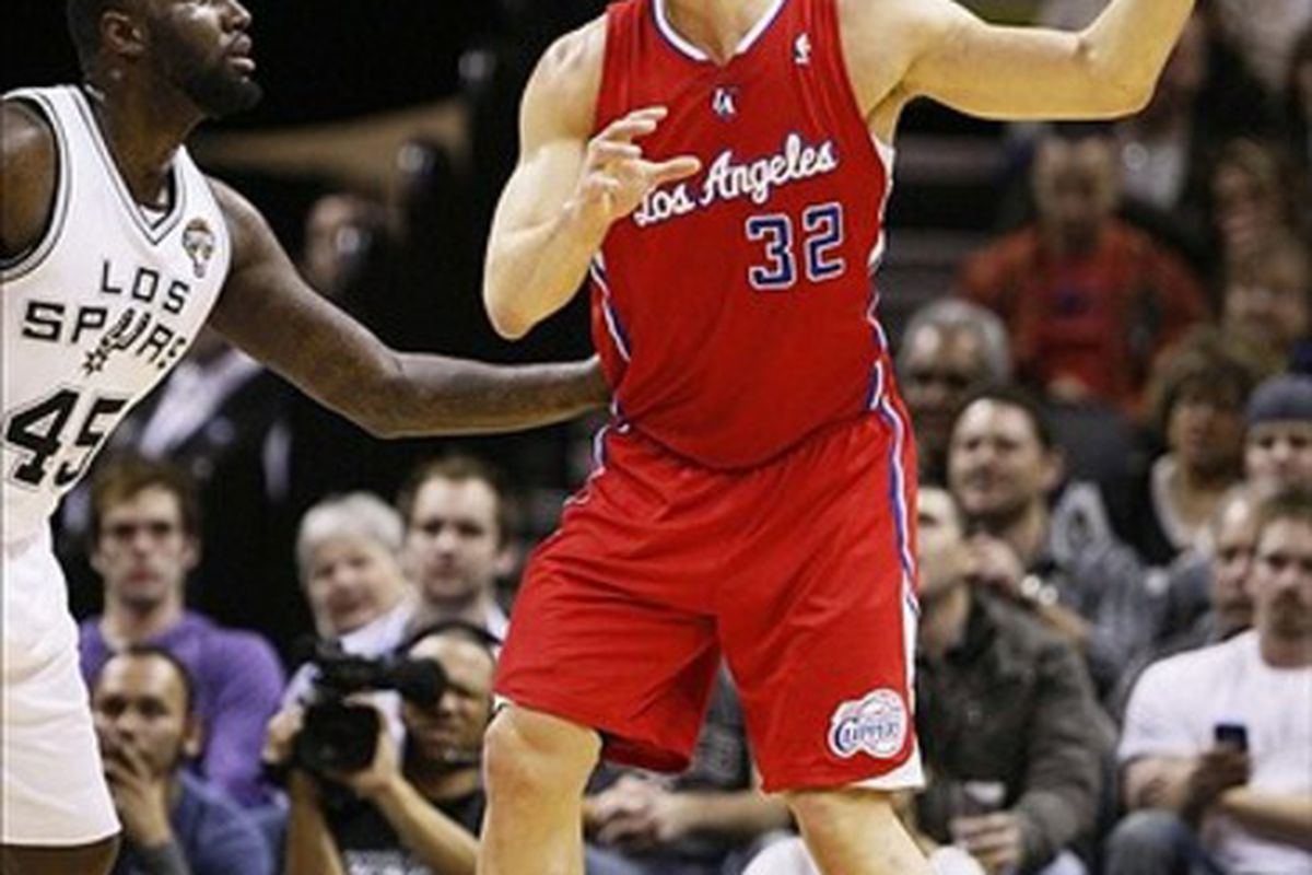 Mar 9, 2012; San Antonio, TX, USA; Los Angeles Clippers forward Blake Griffin (32) is defended by San Antonio Spurs forward DeJuan Blair (45) during the first half at the AT&T Center. Mandatory Credit: Soobum Im-US PRESSWIRE