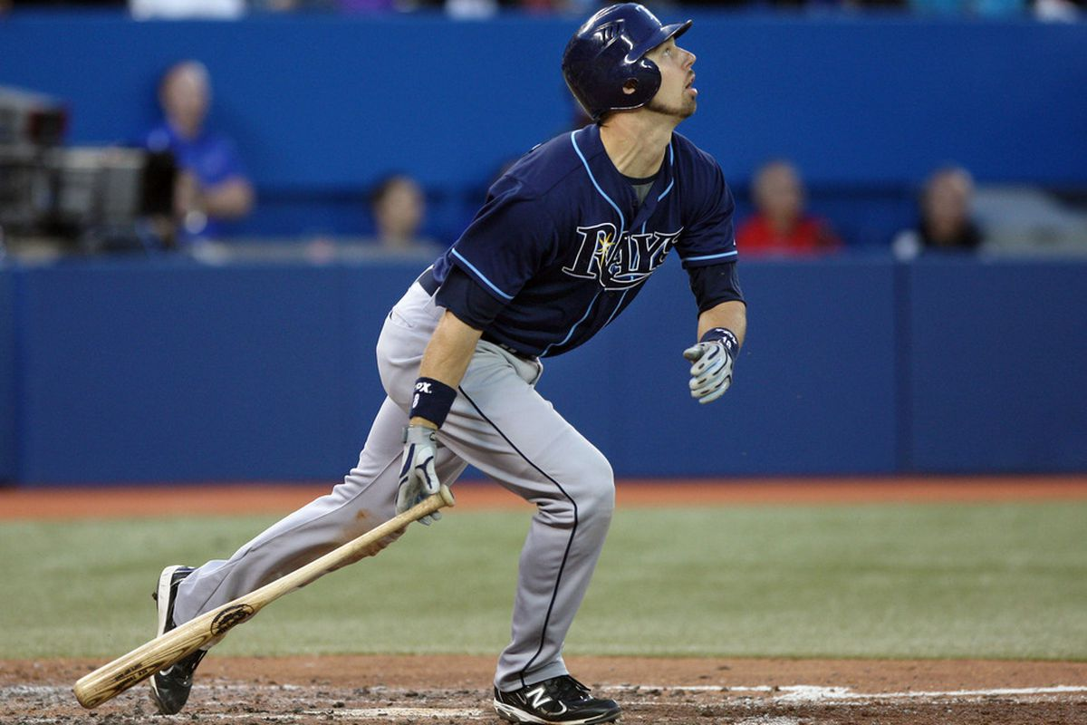 May 15, 2012; Toronto, ON, Canada; Tampa Bay Rays right fielder Ben Zobrist (18) hits an RBI double in the 5th inning against the Toronto Blue Jays at the Rogers Centre. Mandatory Credit: Tom Szczerbowski-US PRESSWIRE