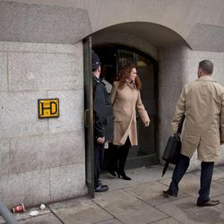 British actor John Alford, left, watches as Rebekah Brooks, center, the former chief of News Corp.'s British operations leaves after appearing in her phone hacking case at the Old Bailey court in the City of London, Wednesday, Sept. 26, 2012.  Brooks and Coulson appeared in London's Old Bailey court Wednesday for a hearing along with five other people charged in connection with the phone hacking scandal that originated at the News of the World tabloid and rocked Rupert Murdoch's News Corp. empire. Rebekah Brooks, the former chief of News Corp.'s British newspapers, and Andy Coulson, the ex-communications chief for Prime Minister David Cameron, learned Wednesday that they will face trial next September over allegations linked to phone hacking.
