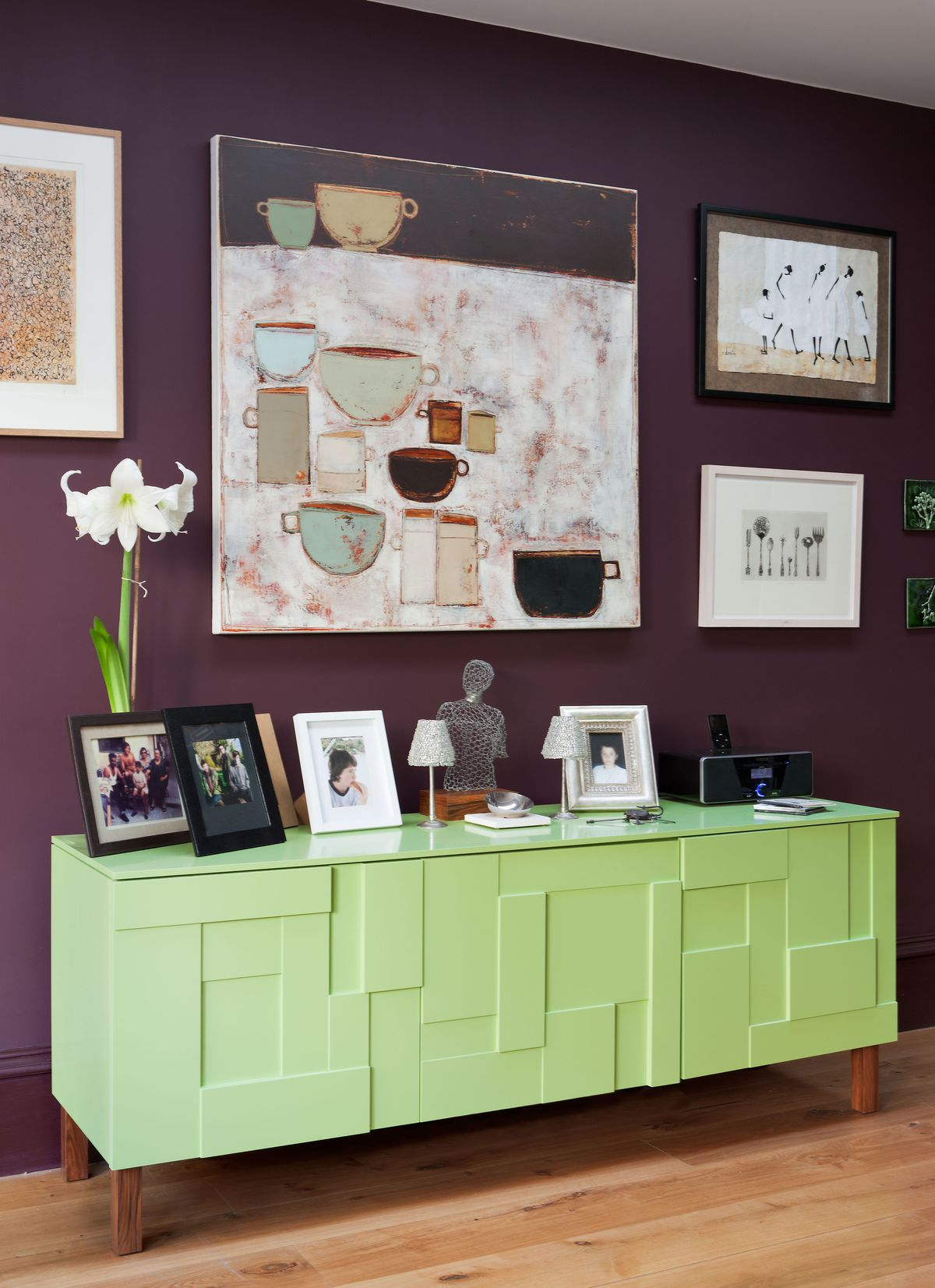 Red-violet wall with a yellow-green cabinet.