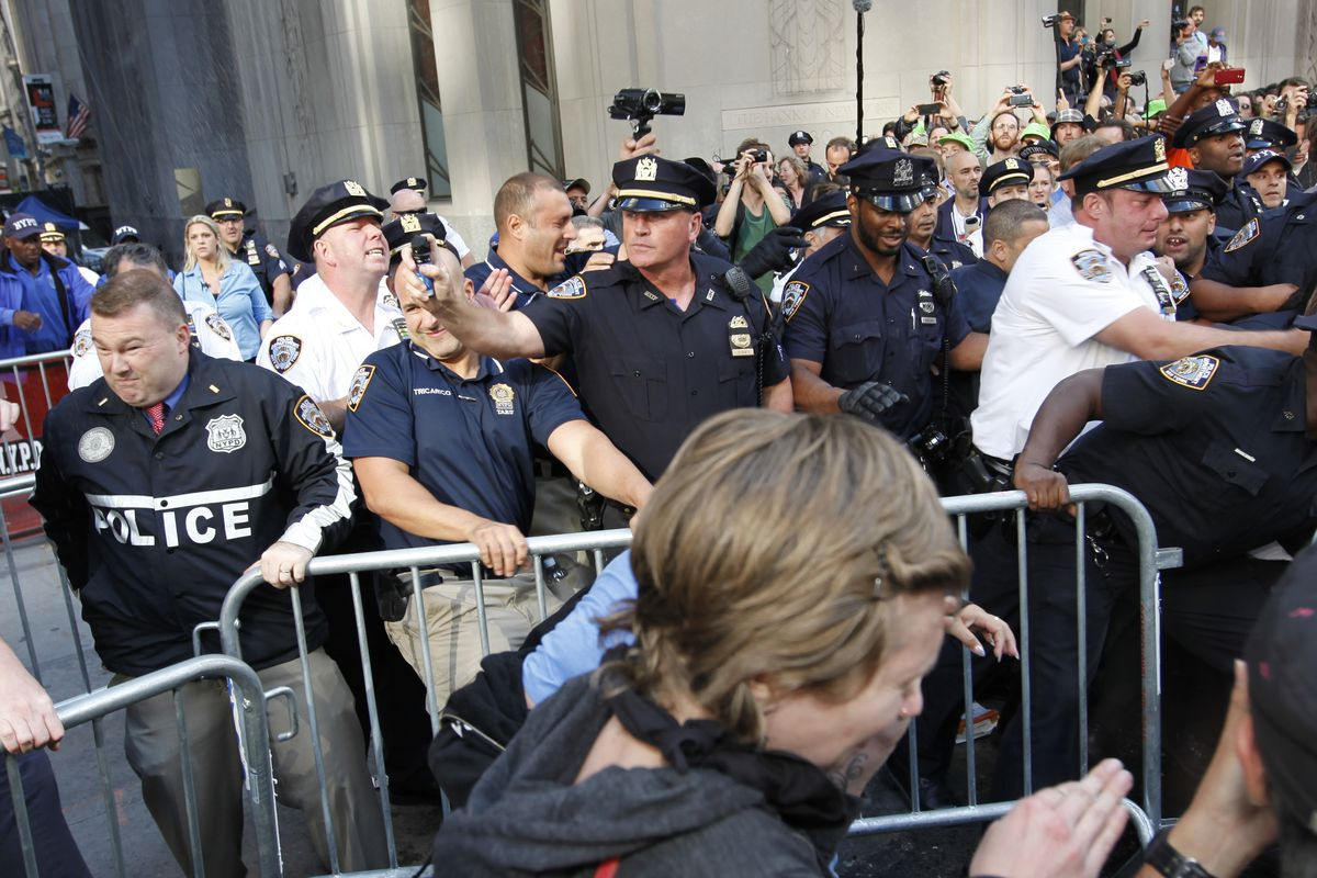 An NYPD officer fires pepper spray during a 2014 protest.