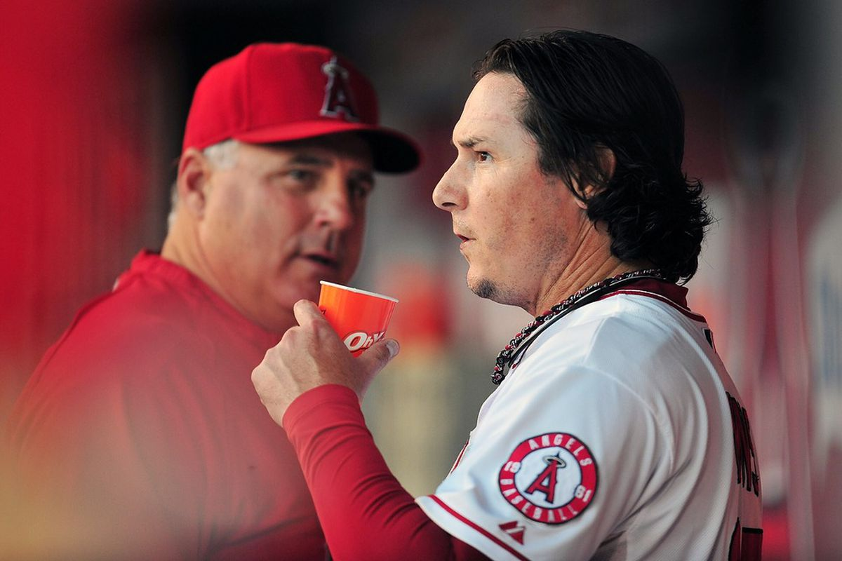 May 15, 2012; Anaheim, CA, USA; Los Angeles Angels manager Mike Scioscia (14) speaks with relief pitcher Scott Downs (37) during the ninth inning against the Oakland Athletics at Angel Stadium. Mandatory Credit: Gary A. Vasquez-US PRESSWIRE