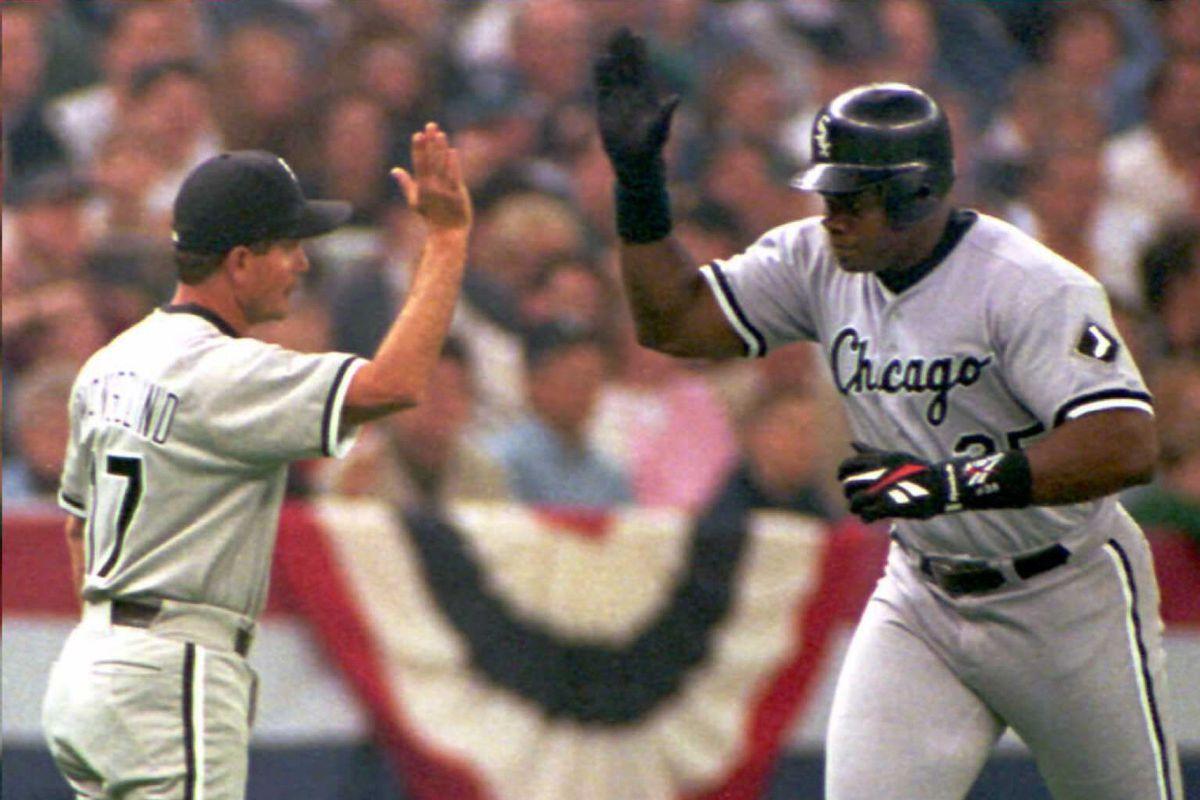 Chicago White Sox slugger Frank Thomas (R) is cong
