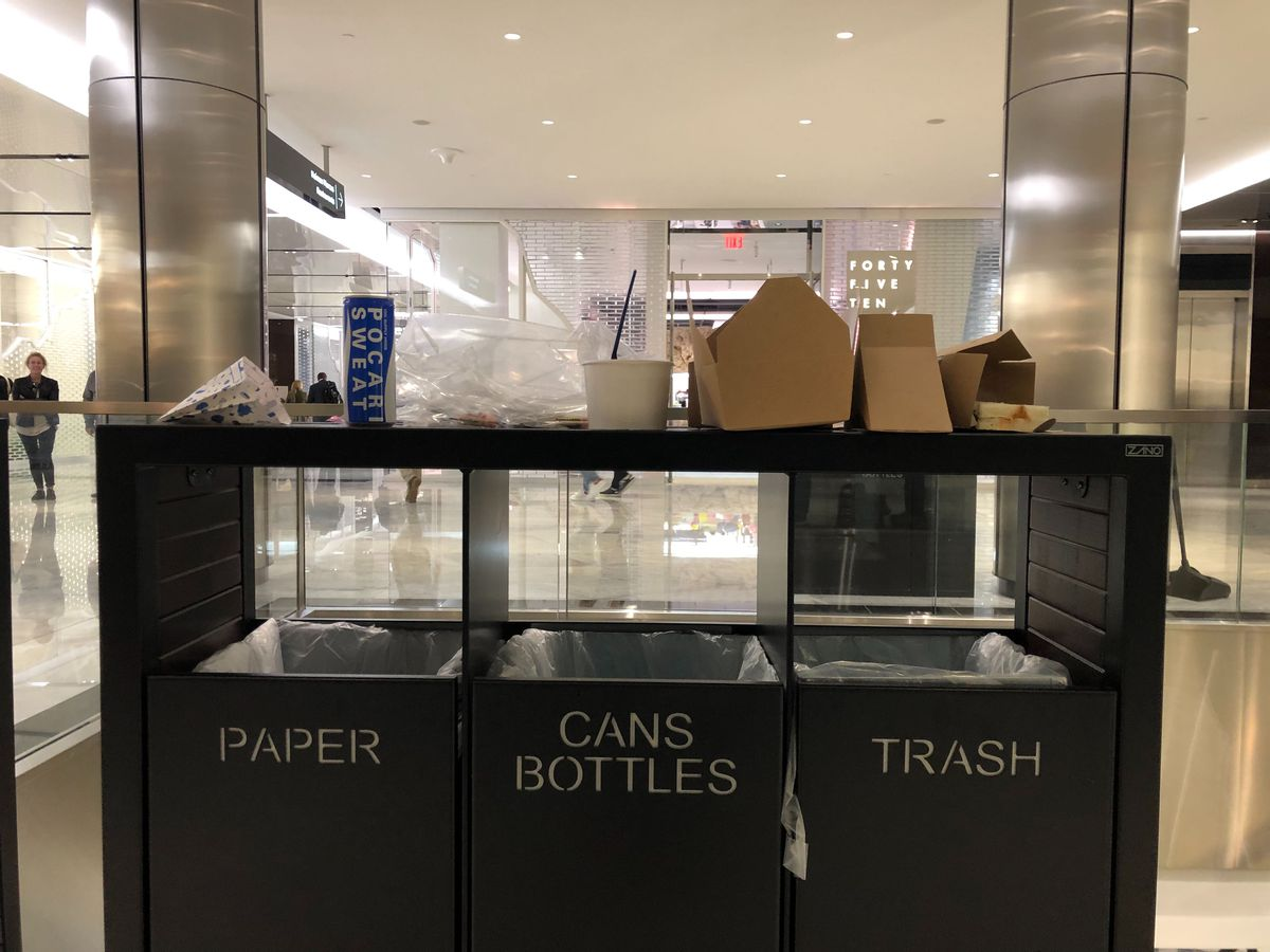 Dining on trash cans in Shops at Hudson Yards