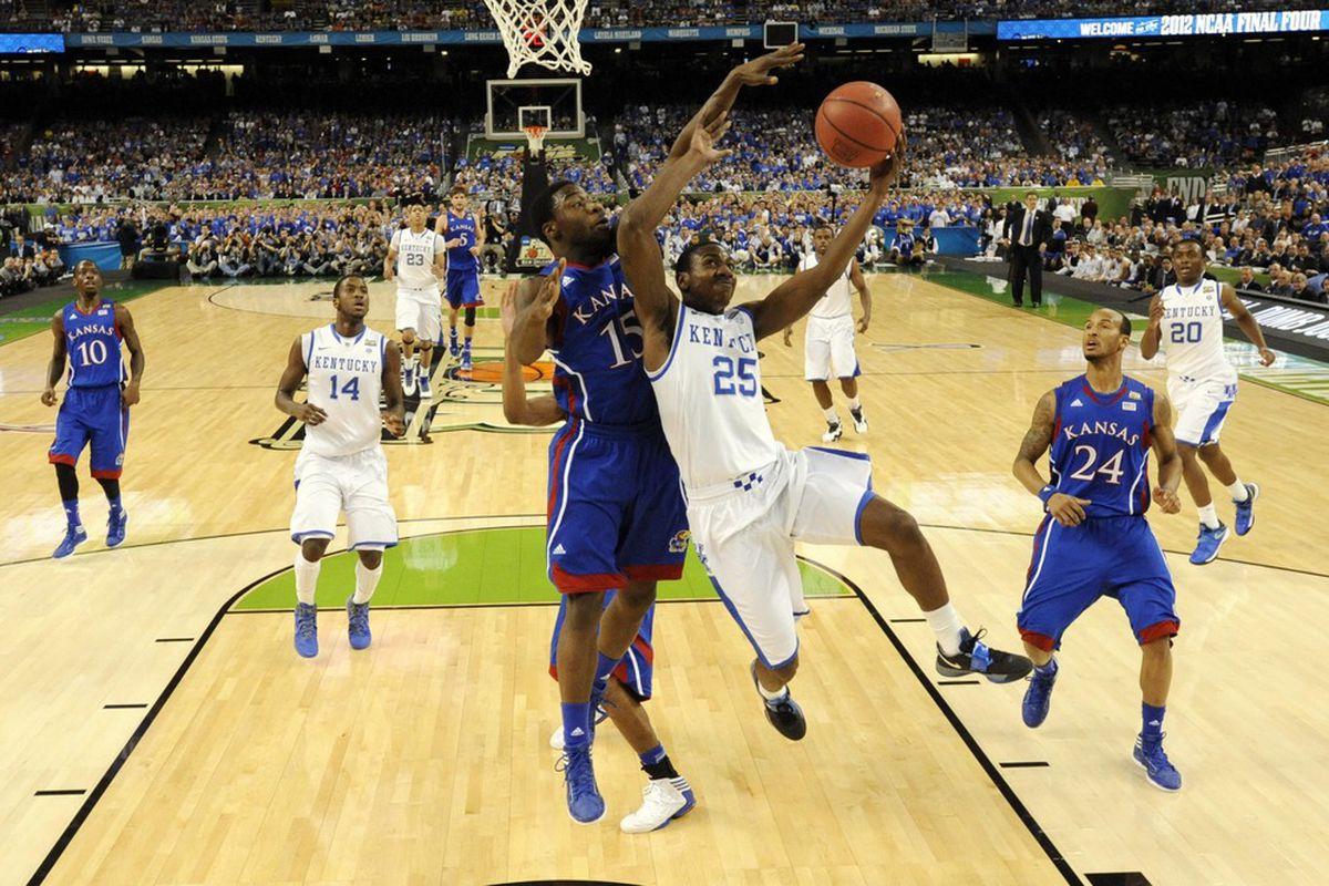 Kentucky guard Marquis Teague (25) shoots over Kansas Jayhawks guard Elijah Johnson (15) during the NCAA finals.