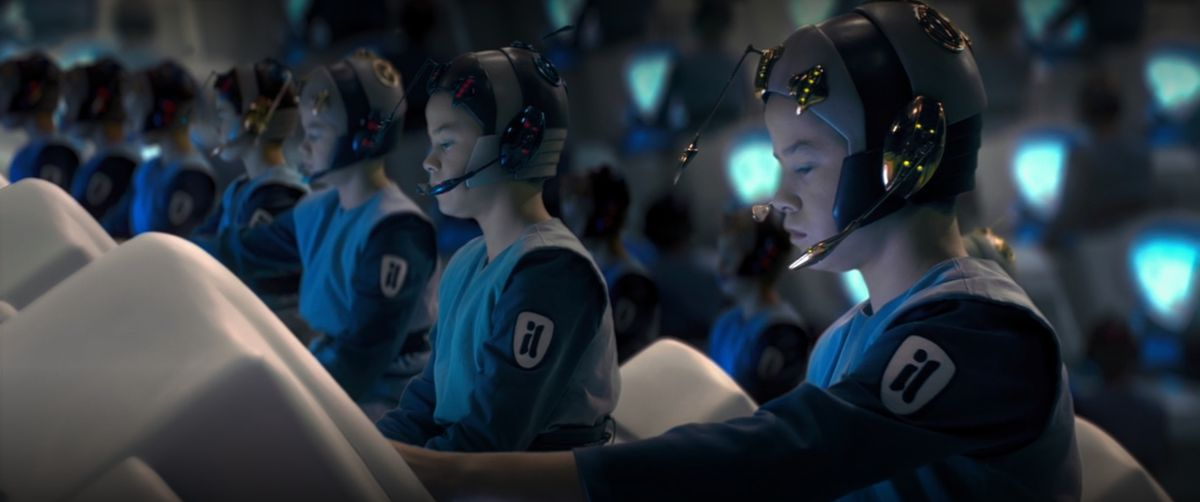 Several identical looking children, clones, sit at computers in Star Wars Episode 2: Attack of the Clones