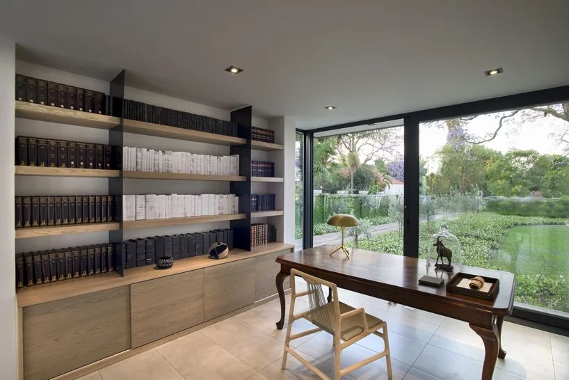 Book-lined office with large windows