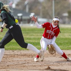 Clearfield runner Rachael Brown gets hit by a batted ball as Bountiful's Livi Arona tries to get into position to field the ball from her second base position during a game at Millcreek Junior High School in Bountiful on Wednesday, March 24, 2021. Brown was called out on the play.