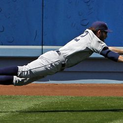 San Diego outfielder Chris Denorfia chases a double by the L.A.'s Juan Uribe on Sunday.  in the second inning of a baseball game in Los Angeles, Sunday, April 15, 2012. (AP Photo/Reed Saxon)