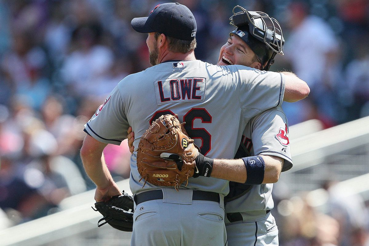 May 15, 2012; Minneapolis, MN, USA: Derek Lowe (26) and catcher Lou Marson (6) yuk it up after beating the hapless Twins.