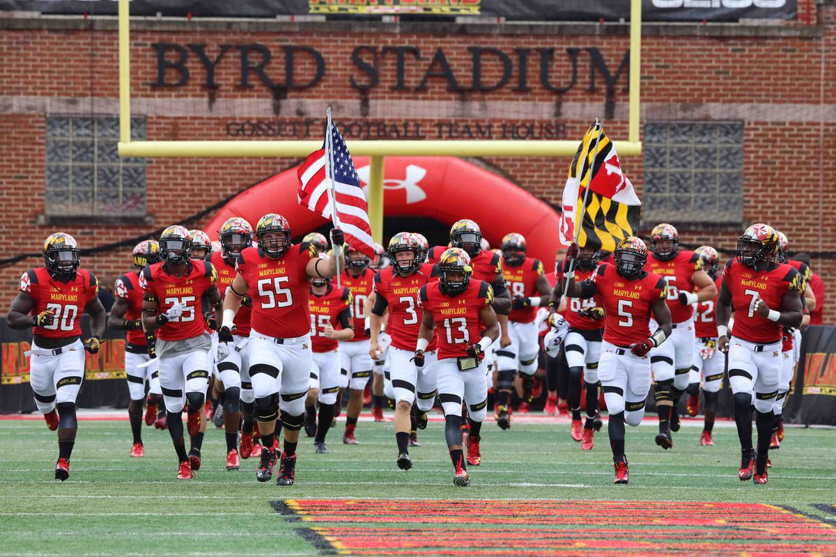 Ryan Doyle (55) leads Maryland's football team out of the tunnel this fall.