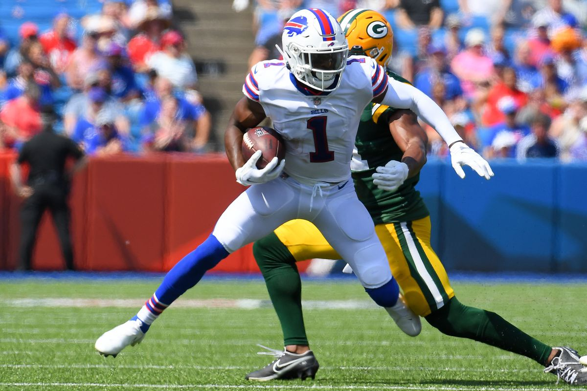 Buffalo Bills wide receiver Emmanuel Sanders (1) runs with the ball after a catch as Green Bay Packers safety Henry Black (back) defends during the first quarter at Highmark Stadium.
