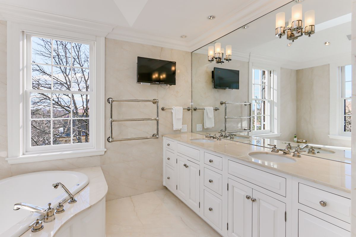 Bathroom with large towel and beige walls.