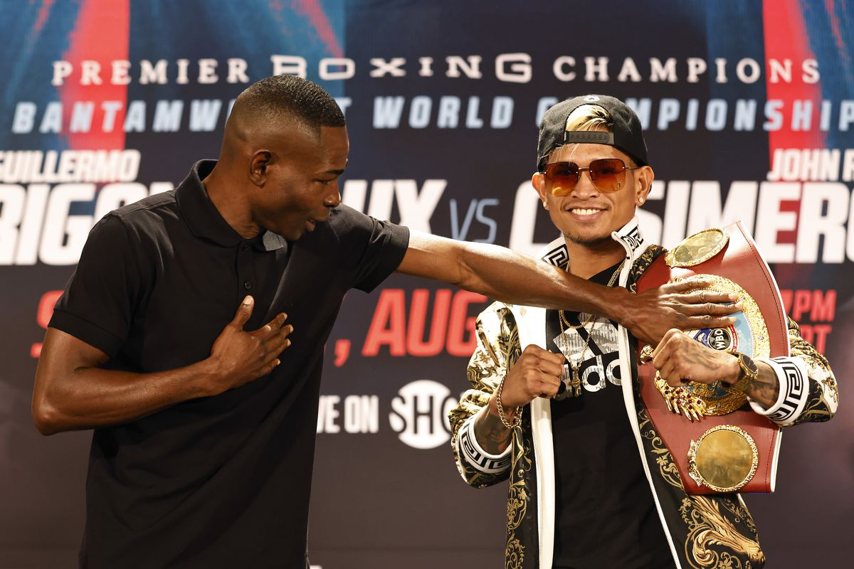 Guillermo Rigondeaux (L) and John Riel Casimero (R) face off during their press conference at the Hyatt Regency at LAX on August 12, 2021 in Los Angeles, California ahead of their Bantamweight World Championship fight on August 14, 2021 at Dignity Health Sports Park in Carson, California.