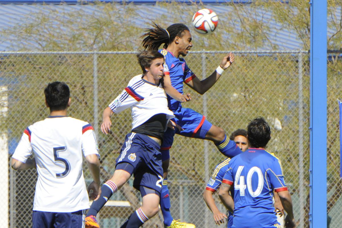 Borja (No. 5) and Calvert (jumping) in 2014 preseason action.
