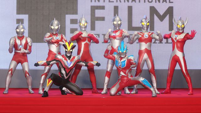 Eight Ultraman characters pose for a photo at the opening ceremony during the 27th Tokyo International Film Festival