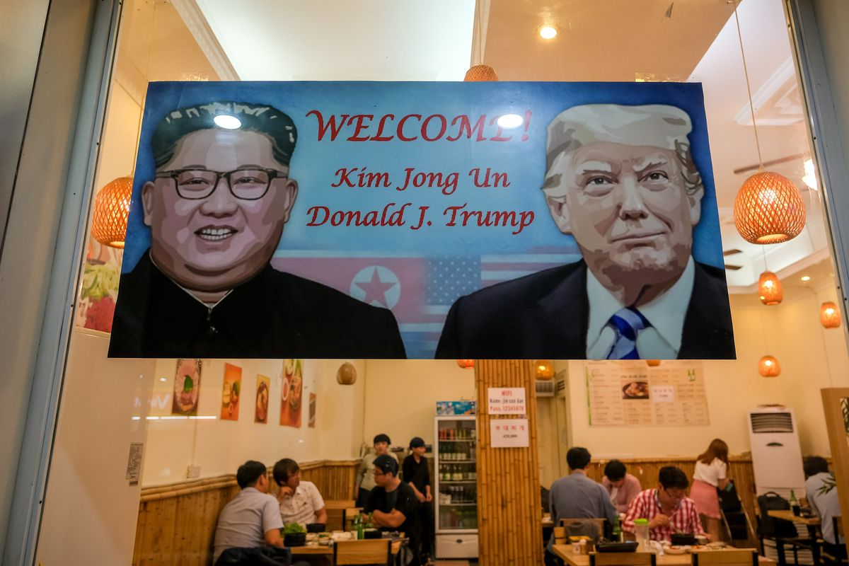 A signboard welcomes the upcoming summit between President Donald Trump and North Korean leader Kim Jong Un at South Korean restaurant on February 20, 2019, in Hanoi, Vietnam.