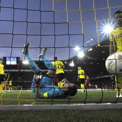 Yopung Boys'  goalie Marco Woelfli lies on his back after Liverpool's Andre Wisdom scored the 1-2 during the UEFA Europa League Group A soccer match between BSC Young Boys Bern and Liverpool FC at the Stade de Suisse in Bern, Switzerland, Thursday, September 20, 2012.