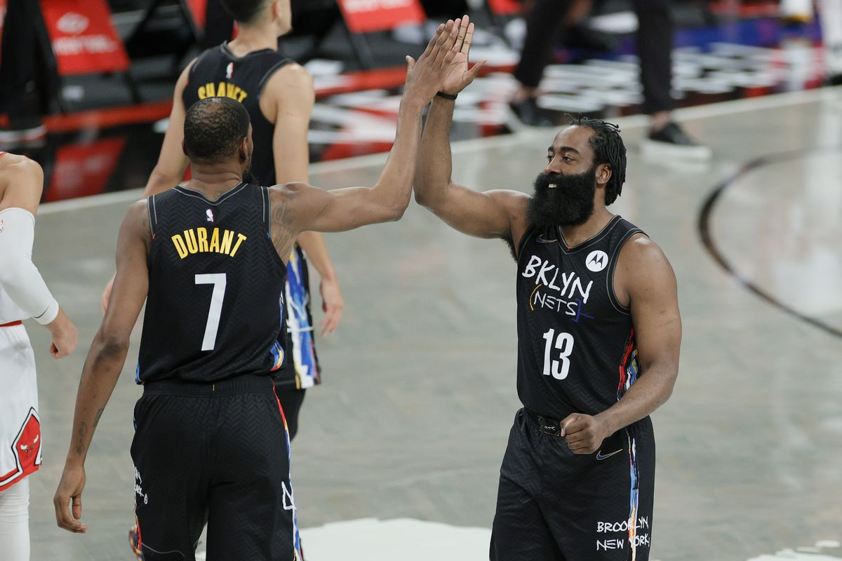James Harden #13 high-fives Kevin Durant #7 of the Brooklyn Nets during the second half against the Chicago Bulls at Barclays Center on May 15, 2021 in the Brooklyn borough of New York City. The Nets won 105-91.