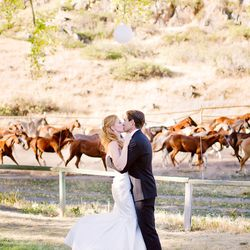 """""""Ben and I were married at Eaton's Dude Ranch in WY and as we shared our first kiss, 200 horses stampeded behind us. It was absolutely breathtaking and felt like something out of a movie."""""""