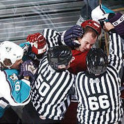 Members of the Grizzlies and Mighty Ducks mix it up during Cincinnati's shootout victory on Wednesday night at the E Center.