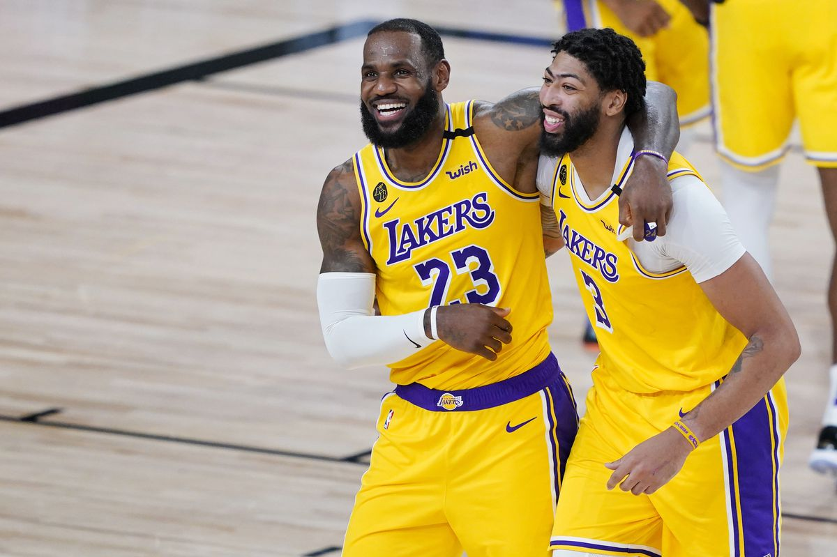 Los Angeles Lakers' LeBron James (23) and Anthony Davis (3) celebrate after defeating the Denver Nuggets 124-121 during an NBA basketball game Monday, Aug. 10, 2020, in Lake Buena Vista, Fla.