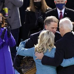 President Joe Biden is congratulated by first lady Jill Biden, his son Hunter Biden and daughter Ashley Biden after being sworn-in during the 59th Presidential Inauguration at the U.S. Capitol in Washington, Wednesday, Jan. 20, 2021. Vice President Kamala Harris applauds at left.
