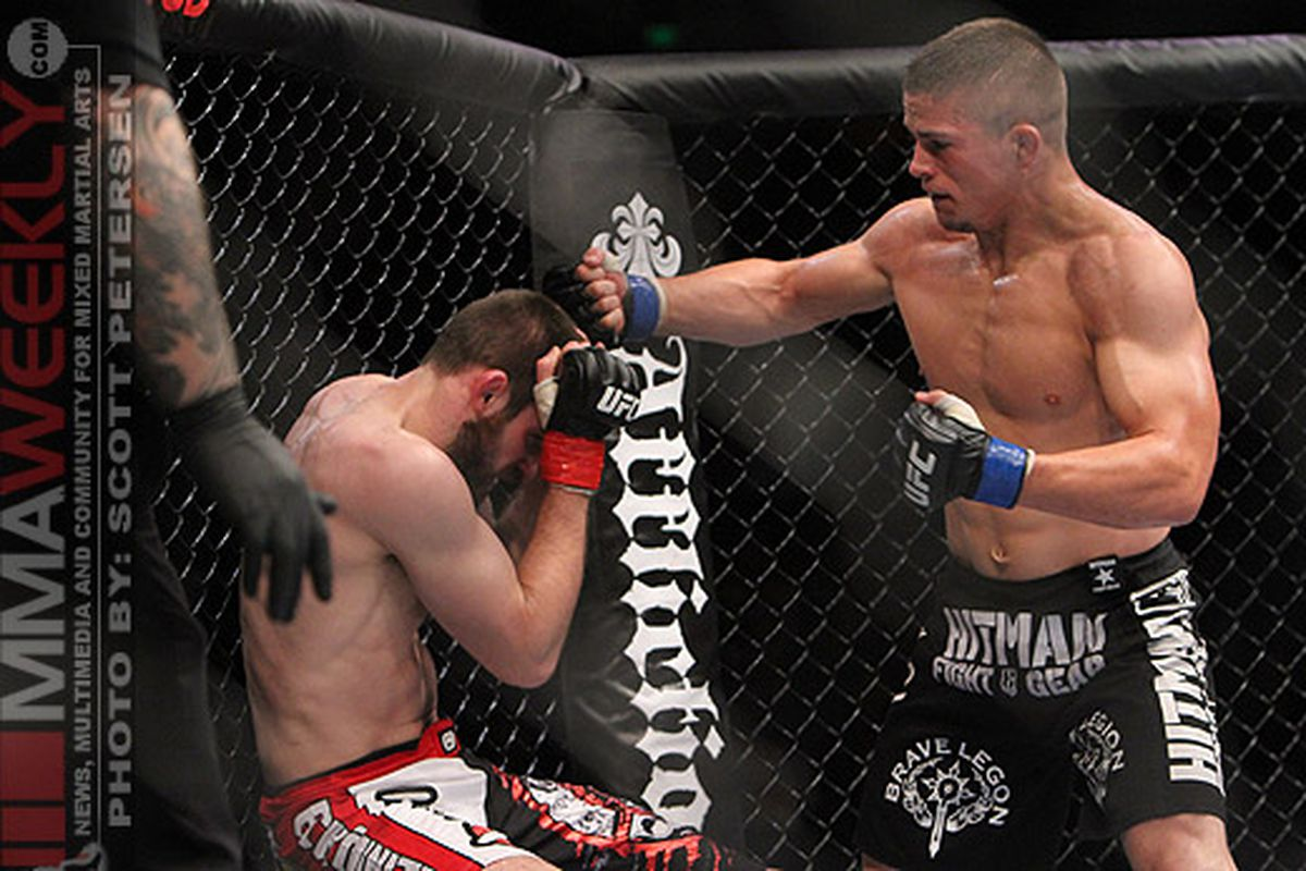 """Rick Story pounds on Dustin Hazelett at UFC 117. Story wants Thiago Alves in his next fight. <em>Photo by Scott Petersen/<a href=""""http://mmaweekly.com"""" target=""""new"""">MMAWeekly.com</a></em>"""