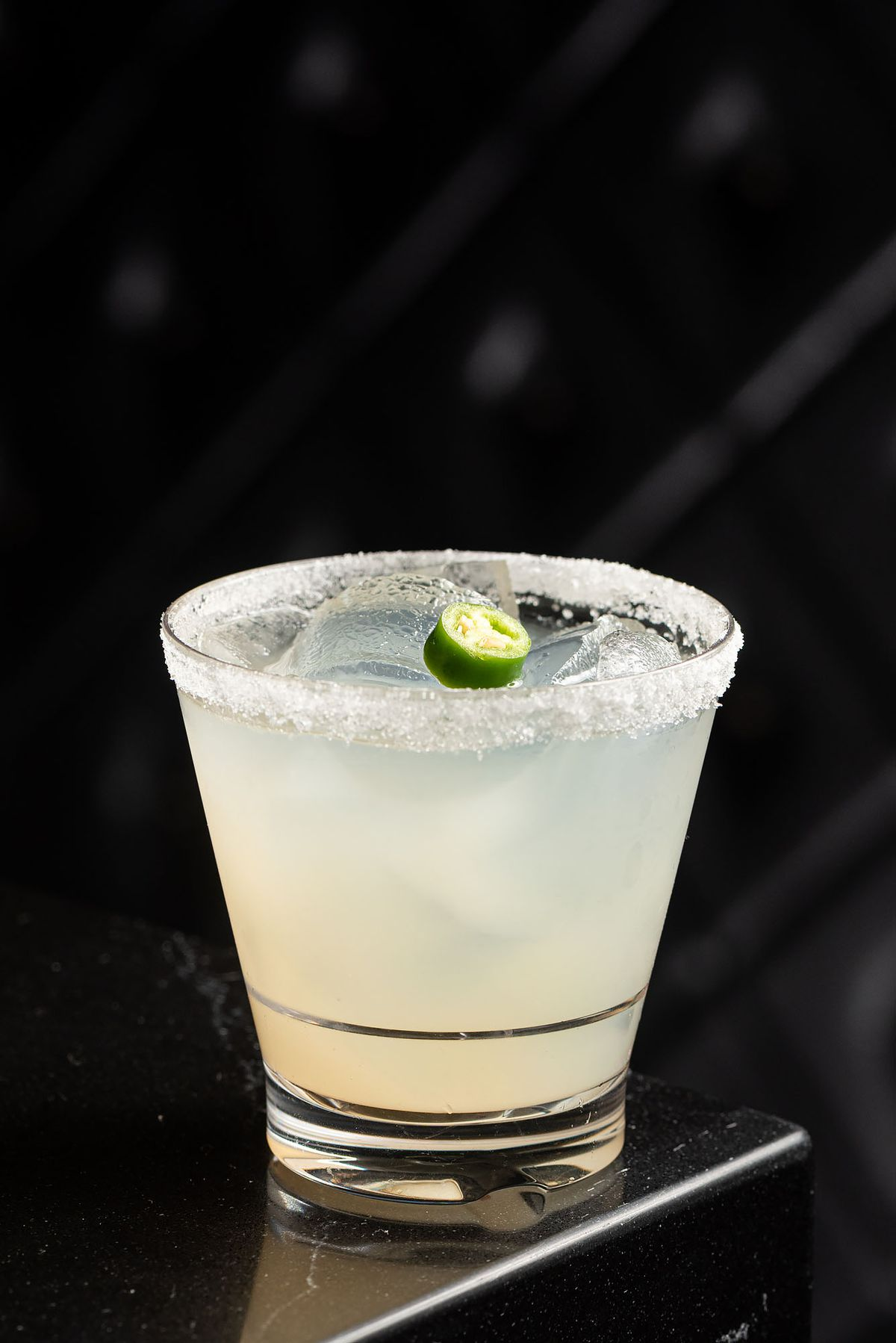 A light white cocktail with salted rim.