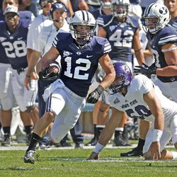 Brigham Young Cougars wide receiver JD Falslev (12) runs as Brigham Young University defeats Weber State University in football 45-6 Saturday, Sept. 8, 2012, in Provo, Utah.