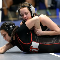 Amber Nalder of Fremont works to control the arm as she and Abby Fue of West wrestle in class 132 as girls compete for the 6A State Wrestling championship at West Lake High in Saratoga Springs on Monday, Feb. 15, 2021.