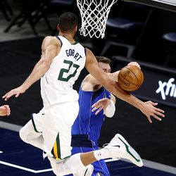 Utah Jazz center Rudy Gobert (27) knocks down a pass by Dallas Mavericks guard Luka Doncic (77) as the Utah Jazz and the Dallas Mavericks play an NBA basketball game at Vivint Smart Home Arena in Salt Lake City on Wednesday, Jan. 27, 2021.