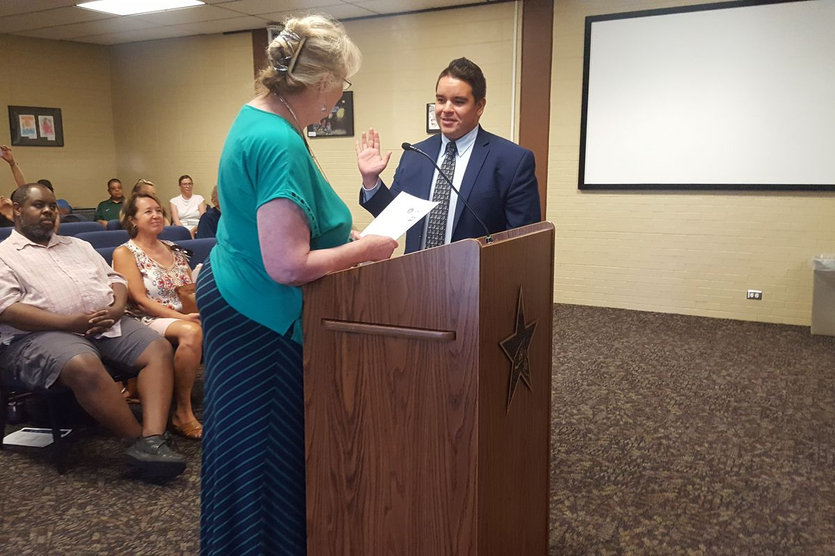 State Sen. Dominick Moreno being sworn in Monday evening.  (Photo by Yesenia Robles, Chalkbeat)
