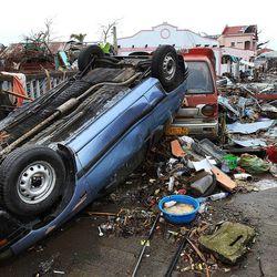 Debris covers a street in Tacloban, Friday, Nov. 22, 2013.