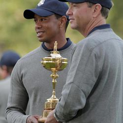 USA's captain Davis Love III and Tiger Woods pose with the trophy during the Ryder Cup PGA golf tournament Tuesday, Sept. 25, 2012, at the Medinah Country Club in Medinah, Ill.