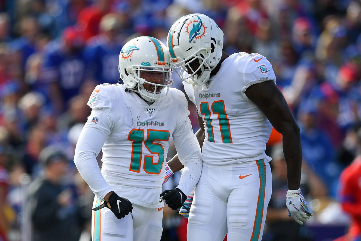 Miami Dolphins wide receiver Albert Wilson reacts to his catch with teammate wide receiver DeVante Parker against the Buffalo Bills during the second quarter at New Era Field.