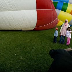 The Kergaye family of Salt Lake City take photos of one another as the balloons are filled prior to flight at the Ogden Valley Balloon Festival  held in Weber County on  Friday.