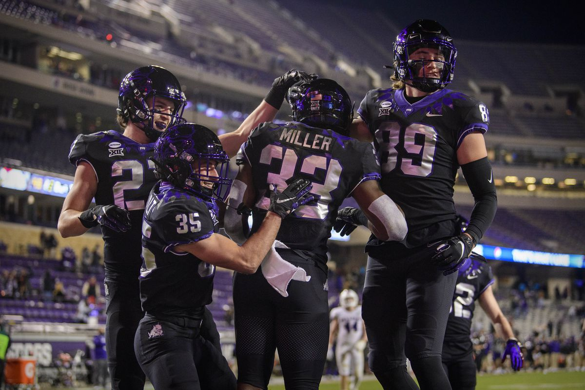 TCU Horned Frogs wide receiver Jack Heathcott (27) and wide receiver Lex Boucvalt (35) and running back Kendre Miller (33) and wide receiver Jack Powers (89) celebrate a touchdown by Miller against the Louisiana Tech Bulldogs during the second half at Amon G. Carter Stadium.