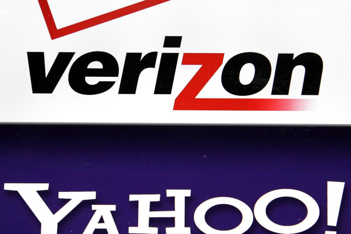 FILE - This Monday, July 25, 2016, file photo shows the Verizon and Yahoo logos on a laptop, in North Andover, Mass. Verizon is buying Yahoo in hopes of challenging Google and Facebook in the digital advertising market by combining ad technologies and use