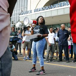 FILE – In this Sept. 17, 2017 file photo, Cori Bush speaks on a bullhorn to protesters outside the St. Louis Police Department headquarters in St. Louis. Six deaths, all involving men with connections to protests in Ferguson, Missouri, drew attention on social media and speculation in the activist community that something sinister was at play. Bush said her car has been run off the road, her home has been vandalized, and in 2014 someone shot a bullet into her car, narrowly missing her daughter, who was 13 at the time. Activists and observers remain puzzled, especially since people involved in the protests continue to face harassment and threats. (AP Photo/Jeff Roberson, File)
