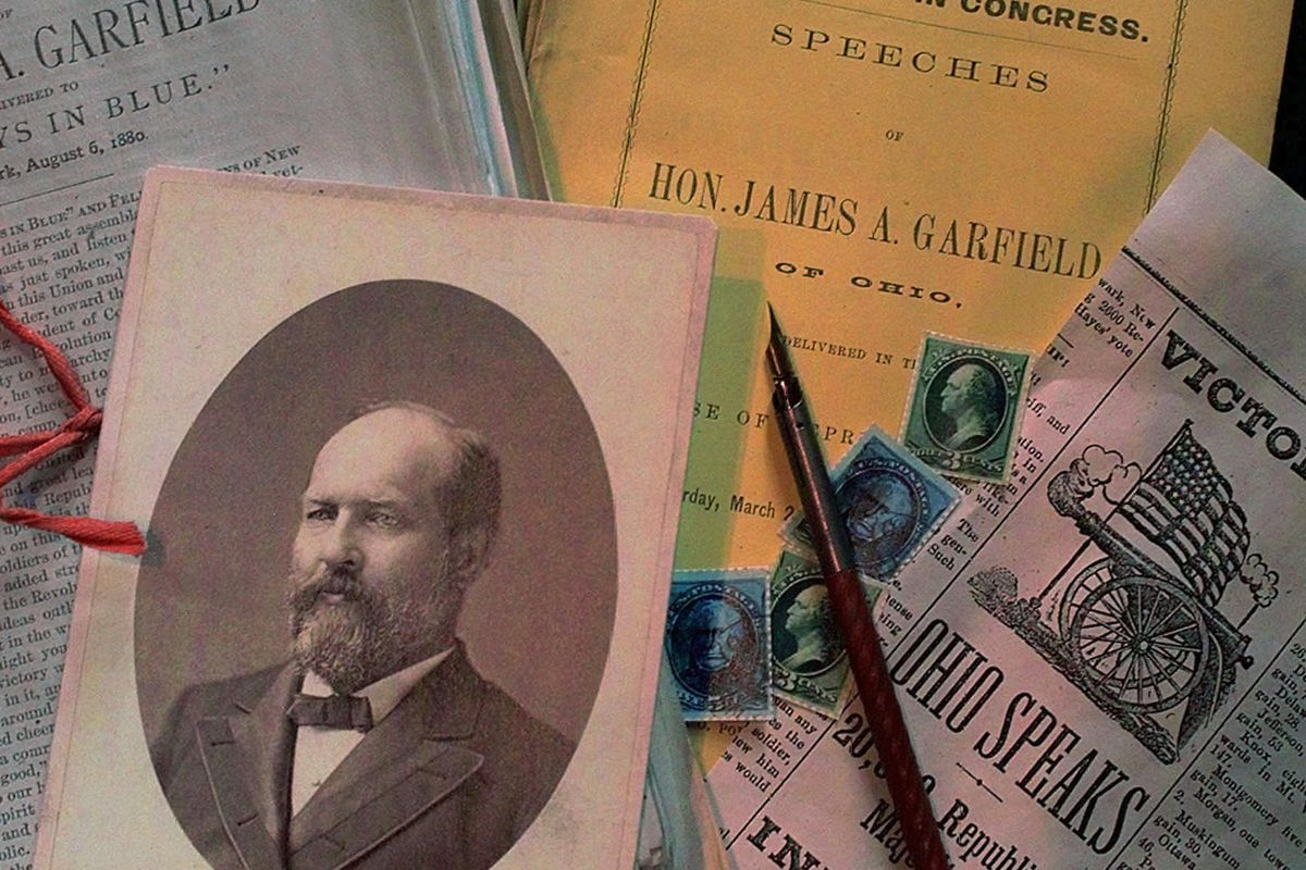 Photograph of James A. Garfield, 20th President of the United States, lies amid various Garfield ephemera.