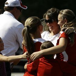 Arie and Amanda Naylor celebrate with their mom, Alisha after winning the State 2A Tennis first seed doubles tournament at Liberty Park in Salt Lake City Saturday, Sept. 29, 2012.