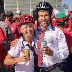 Wisconsin fans Matt Frey and Krista Deutsch-Frey dress up like LDS missionaries during the Wisconsin-BYU football game Saturday in Provo.