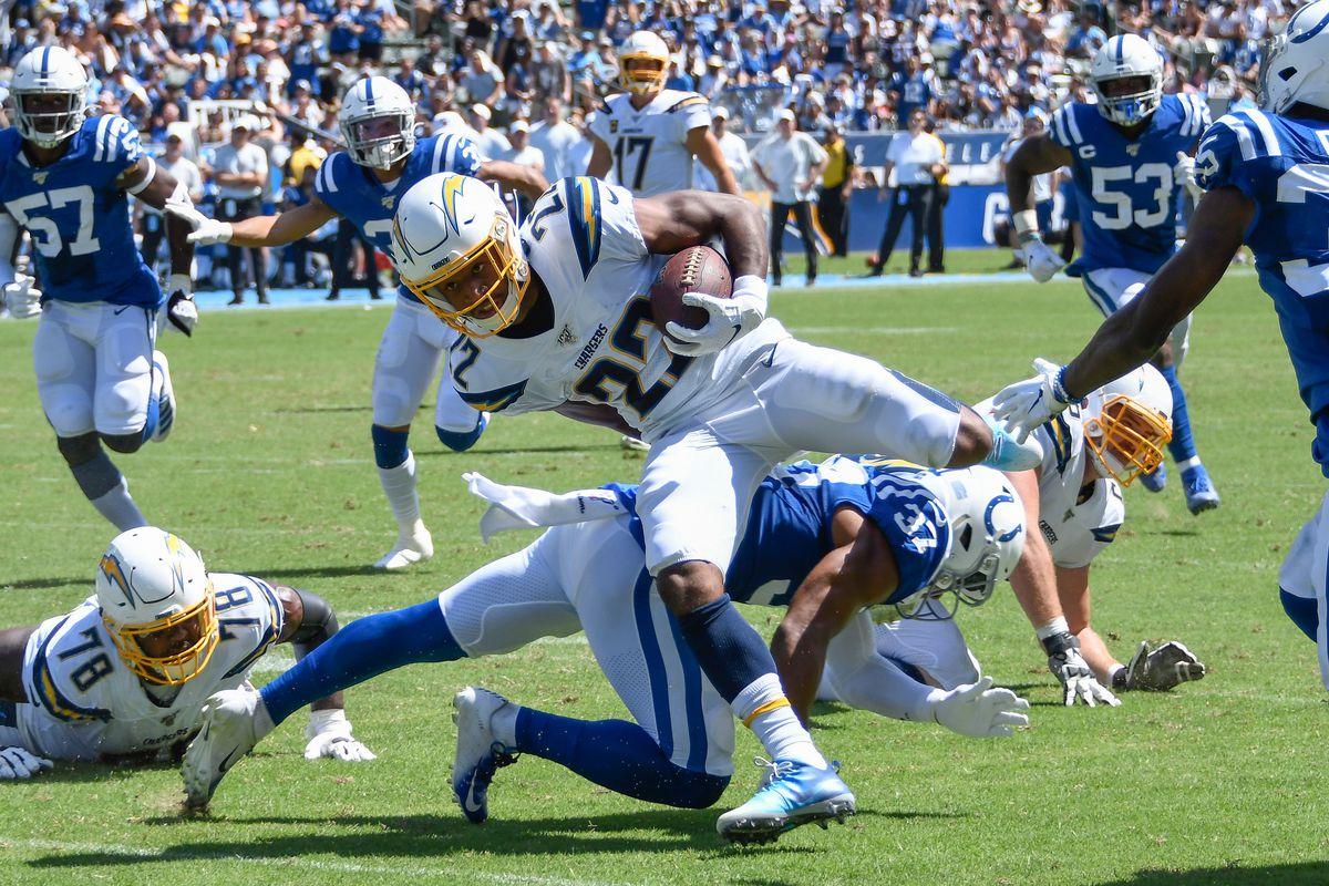 Los Angeles Chargers running back Justin Jackson hurdles Indianapolis Colts safety Khari Willis during the 2nd quarter at Dignity Health Sports Park.