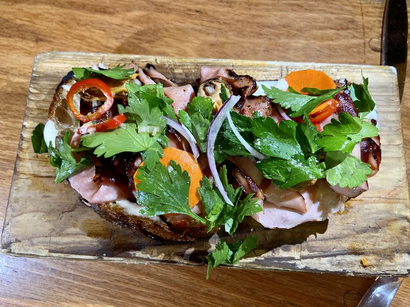 Fried mortadella, oysters, chilies, and herbs on toast.